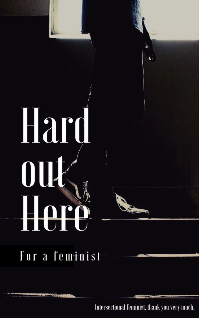 "The picture is meant to look like a novel cover. In a dark black and white photo, confortable shoes in jeans climb up steps. The title and subtitle text reads ""hard out here for a feminist,"" and small text at the bottom reads, ""intersectional feminist, thank you very much."""